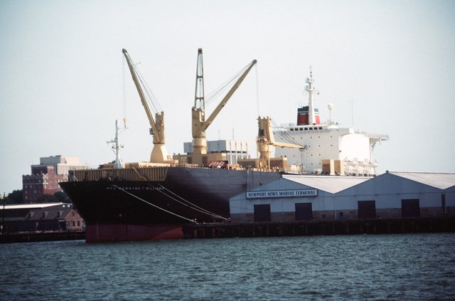 A low angle port bow view of the vehicle cargo ship SS PFC. DEWAYNE T. WILLIAMS (T-AKR) moored at the Newport News Marine Terminal. This is the second converted Maersk ship to be used with the Maritime Prepositioning Ship (MPS) force, which is under charter to the Military Sealift Command