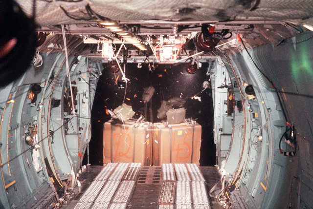 Two pallets of supplies are dropped from a C-141B Starlifter aircraft over the South Pole. The drop is a joint US/New Zealand operation to resupply both South Pole and McMurdo Stations in Antarctica. The operation is being staged from Detachment 2, 619th Military Airlift Support Squadron, at the New Zealand International Airport