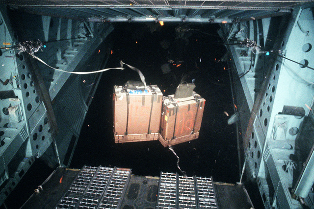 Two pallets of supplies are dropped from a C-141B Starlifter aircraft over the South Pole. The drop is a joint U.S./New Zealand operation to resupply both South Pole and McMurdo Stations in Antarctica. The operation is being staged from Det. 2, 619th Military Airlift Support Squadron, at the New Zealand International Airport