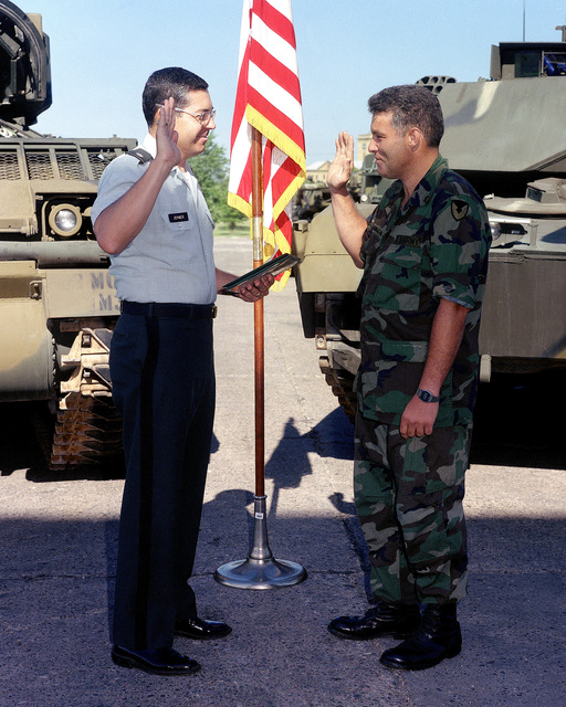 STAFF Sergeant (SSG) Peter Schumacher is sworn in for a five-year re-enlistment by Lieutenant Colonel (LTC) Gary W. Joyner during a ceremony at Rock Island Arsenal