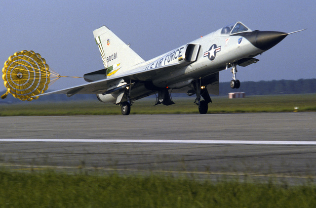An F-106 Delta Dart aircraft from the 49th Fighter Interceptor Squadron deploys a drogue chute upon landing