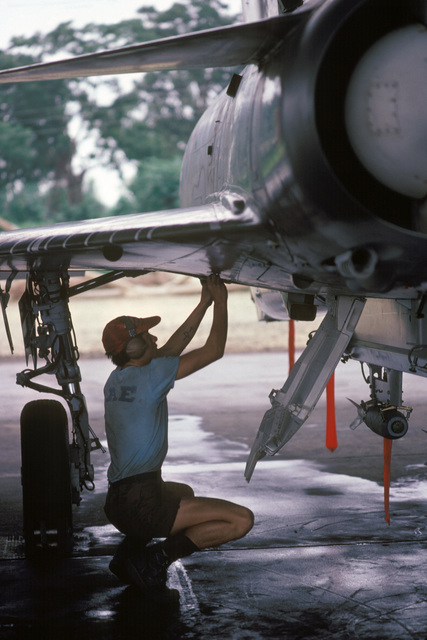 A maintenance technician performs a preflight inspection on an Ecuadorian air force Kfir aircraft during the joint US and Ecuadorian Exercise BLUE HORIZON