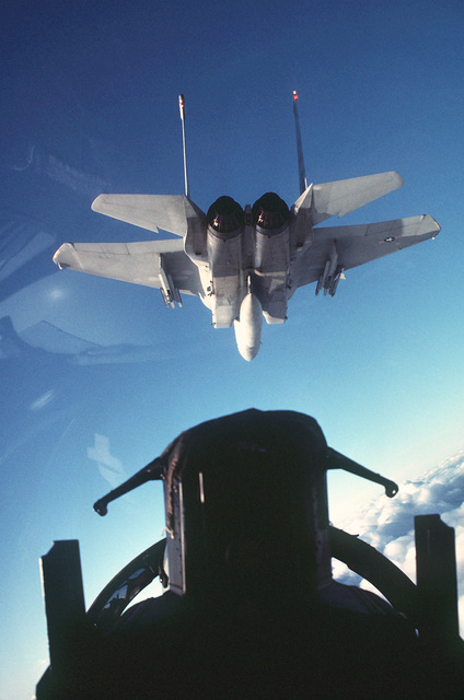 An air-to-air rear view of a 36th Tactical Fighter Wing F-15C Eagle aircraft as seen from the back seat of an F-15D aircraft