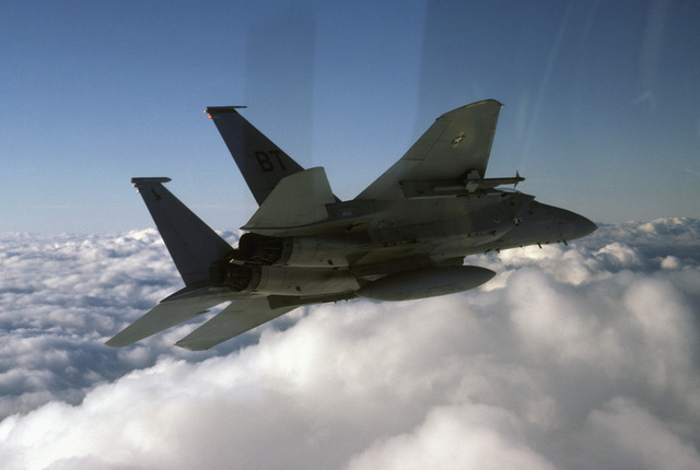 An air-to-air right rear view of a 36th Tactical Fighter Wing F-15C Eagle aircraft