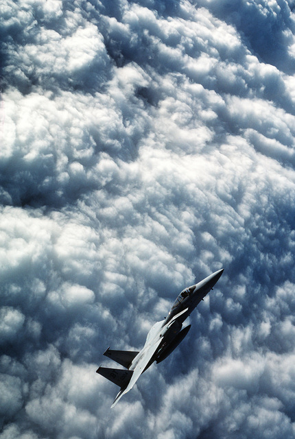 An air-to-air right side view of a 36th Tactical Fighter Wing F-15C Eagle aircraft in a steep climb