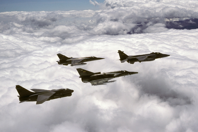 An air-to-air right side view of a US Air Force A-7D Corsair II aircraft, left, in formation with three Ecuadorian aircraft during the joint US and Ecuadorian Exercise BLUE HORIZON. The aircraft are an F-1 Mirage, left center, a Kfir, center, and a Jaguar