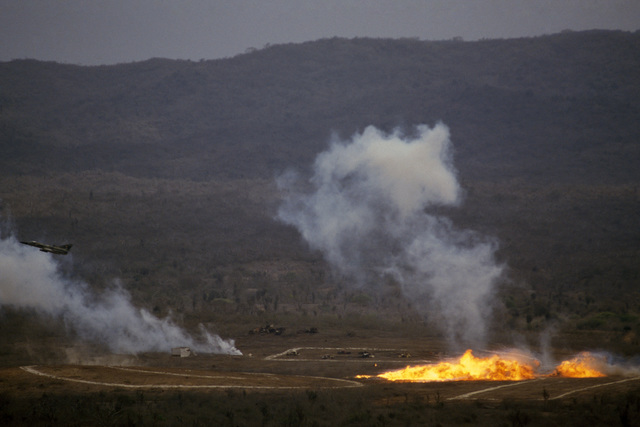 An Ecuadorian air force Kfir aircraft drops napalm on a target range during the joint US and Ecuadorian Exercise BLUE HORIZON