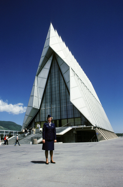 SENIOR AIRMAN (SRA) Kathryn J. Kelleher, 1876th Communications Squadron, and one of the US Air Force's Outstanding Airmen of 1985, stands in front of the Air Force Academy Chapel