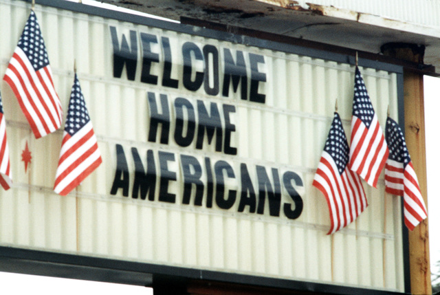 A large welcome home sign surrounded by America flags stands ready to welcome former TWA hostages back to the US. The 39 US citizens had been held captive for 16 days in Beirut, Lebanon, by Shiite Moslem terrorists