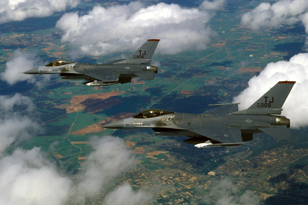An air-to-air left side view of two F-16A Fighting Falcon aircraft assigned to the 614th Tactical Fighter Squadron in formation during a training mission
