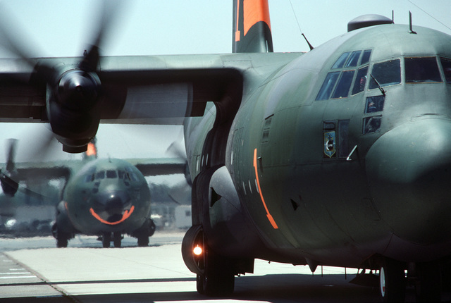 An Air National Guard C-130 Hercules aircraft loaded with chemical fire retardant prepare to take off on a mission. The aircraft are equipped with the Modular Airborne Fire Fighting System (MAFFS) and are participating in fire fighting efforts under the direction of the US Forest Service