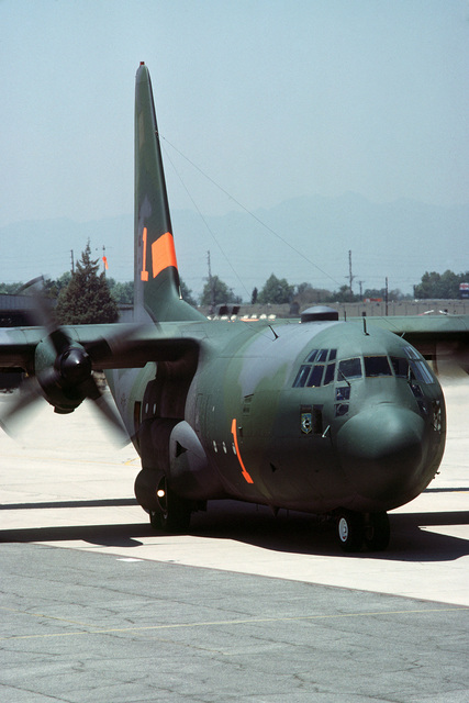 An Air National Guard C-130 Hercules aircraft loaded with chemical fire retardant prepares to take off on a mission. The aircraft is equipped with the Modular Airborne Fire Fighting System (MAFFS) and is participating in fire fighting efforts under the direction of the US Forest Service