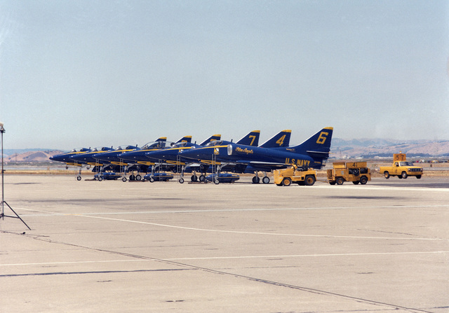 A left side view of five A-4F Skyhawk aircraft and one TA-4J Skyhawk (third from left) of the Navy Blue Angels Flight Demonstration Squadron lined up on the flight line during the air station's annual open house and air show