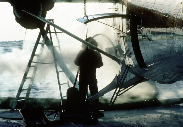A member of a naval scientific research team preheats an aircraft prior to flight at Ice Camp Opal, one of three research stations established on the polar ice cap during the Arctic Research and Environmental Acoustic (AREA) program. AREA '85 is a Navy-sponsored expedition to study oceanography, acoustics, geophysics, communications and submarine warfare in the polar environment