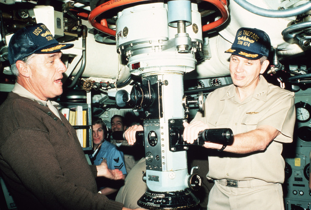Admiral (ADM) James D. Watkins, chief of naval operations, left, and Vice Admiral (VADM) N.R. Thunman, deputy chief of naval operations, submarine USS TREPANG (SSN 674) while inspecting the Arctic Research and Environmental Acoustic (AREA) program. AREA '85 is a Navy-sponsored expedition to study oceanography, acoustics, geophysics, communications and submarine warfare in the polar environment