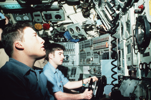 Crewmen monitor instruments aboard the nuclear-powered submarine USS TREPANG (SSN 674) while underway under the ice pack during operations in support the Arctic Research and Environmental Acoustic (AREA) program. AREA '85 is a Navy-sponsored expedition to study oceanography, acoustics, geophysics, communications and submarine warfare in the polar environment