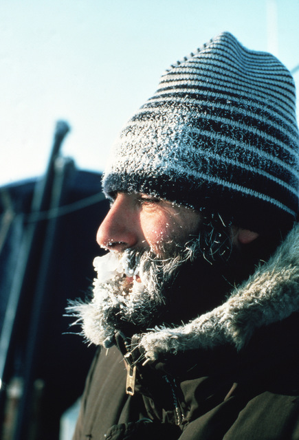 Ice covers the beard of a civilian member of the naval scientific research team at Ice Camp Opal, one of three research stations established on the polar ice cap during the Arctic Research and Environmental Acoustic (AREA) program. AREA '85 is a Navy-sponsored expedition to study oceanography, acoustics, geophysics, communications and submarine warfare in the polar environment