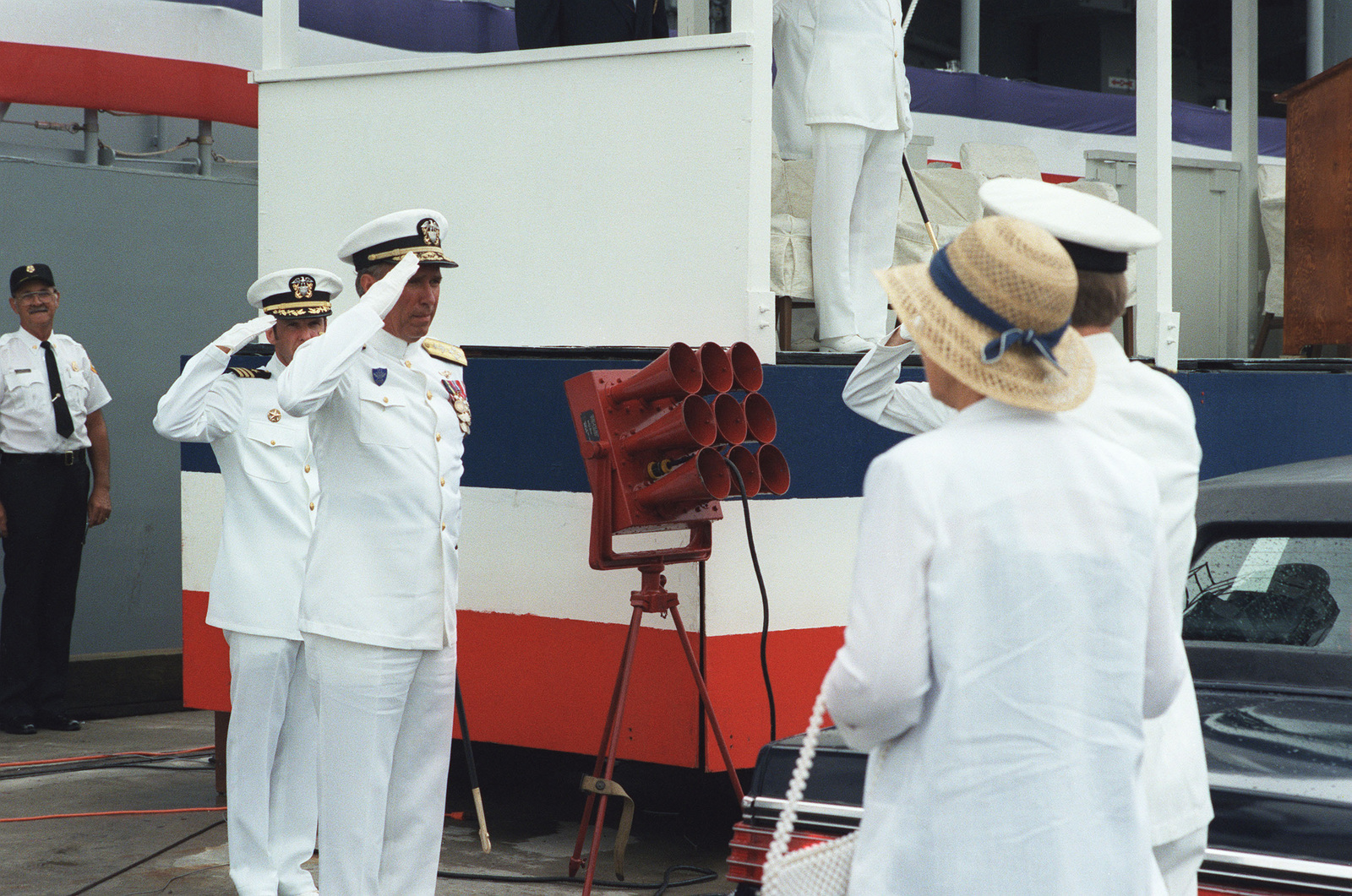 Admiral (ADM) Wesley L. McDonald, commander in chief, Atlantic and Atlantic Fleet, salutes as his wife, Norma Joy McDonald, arrives for the commissioning of the guided missile frigate USS ELROD (FFG 55). Mrs. McDonald is the ship's sponsor