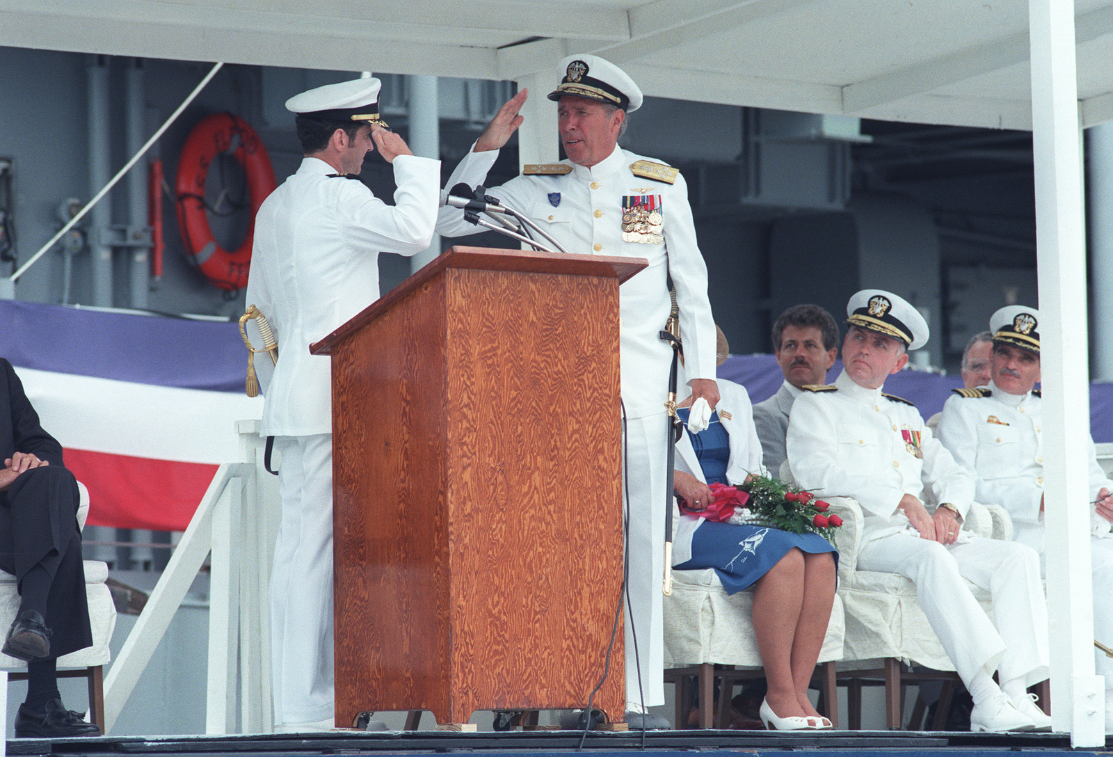 Commander (CDR) R.W. Moore, commanding officer of the guided missile frigate USS ELROD (FFG 55), left, salutes Admiral Wesley L. McDonald, commander in chief, Atlantic and Atlantic Fleet, during the ship's commissioning