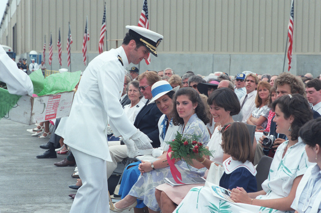 Flowers are presented to a distinguished guest during the commissioning of the guided missile frigate USS ELROD (FFG 55)