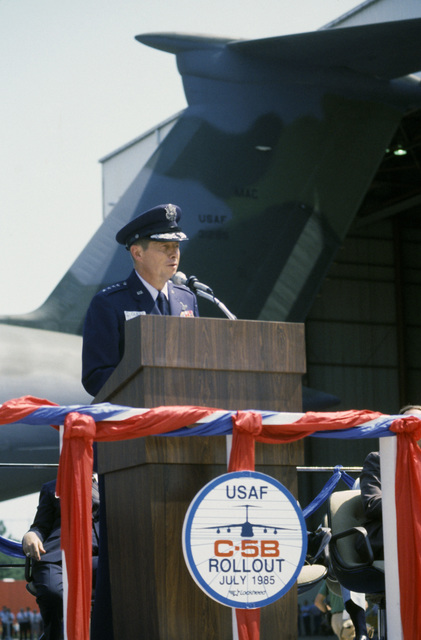 General (GEN) Thomas Ryan Jr., commander in chief, Military Airlift Command, addresses guests at the rollout ceremony of the first C-5B Galaxy aircraft. The ceremony is being held at the Lockheed Aircraft Corp. facility