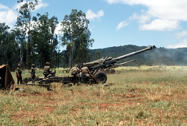 Members of Battery B, 1ST Bn., 12th Marines, prepare to fire an M-198 155mm howitzer during Operation Valiant Fire II