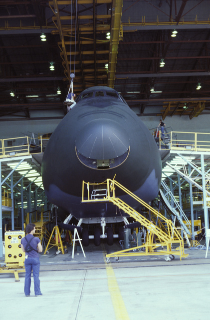 Technicians at the Lockheed Aircraft Corp. facility put the finishing touches on the first C-5B Galaxy aircraft before its rollout ceremony