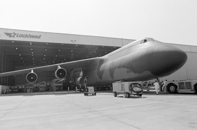 Technicians at the Lockheed Aircraft Corp. facility tow the first C-5B Galaxy aircraft out of a hangar during its rollout ceremony
