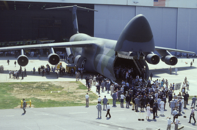 Visitors inspect the first C-5B Galaxy aircraft during its rollout ceremony at the Lockheed Aircraft Corp. facility