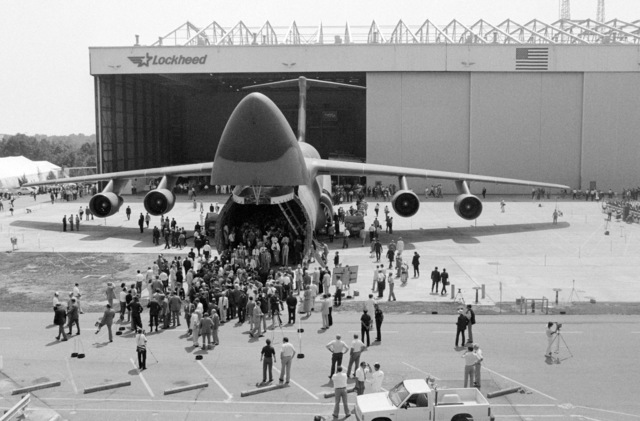 Visitors inspect the first C-5B Galaxy aircraft during its rollout ceremony held at the Lockheed Aircraft Corp. facility