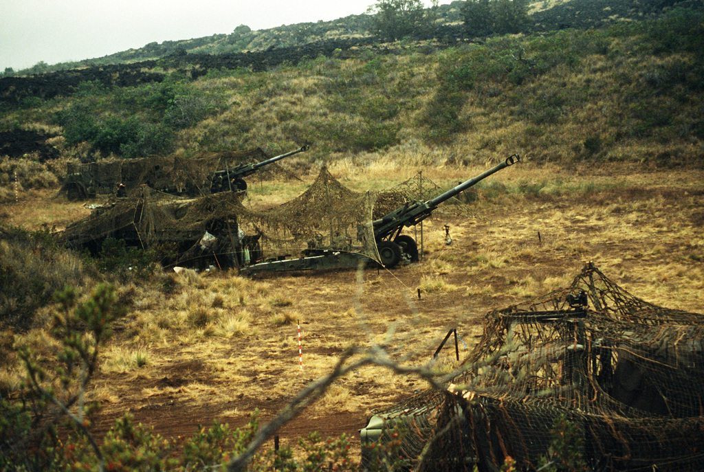 Camouflage covers M-198 155mm howitzers of Battery C, 1ST Bn., 12th Marines, during Operation Valiant Fire II