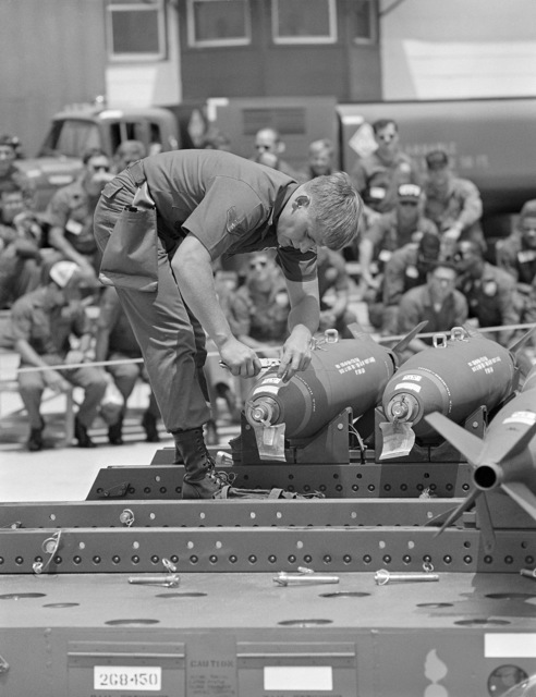 AIRMAN First Class (A1C) Allen Reams, an aircraft armament systems specialist, positions an arming wire on the nose of a Mark 82 500-pound bomb during gunnery meet GUNPOWDER 85