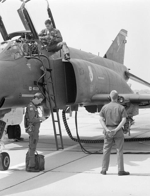 An aircrew prepares to enter the cockpit of an F-4E Phantom II aircraft for a mission during gunnery meet GUNPOWDER 85