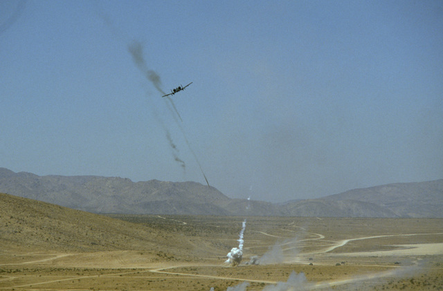 An A-10A Thunderbolt II aircraft launches a salvo of three-inch rockets at a pop-up target on the live fire range during the Air Warrior 85-12 exercise
