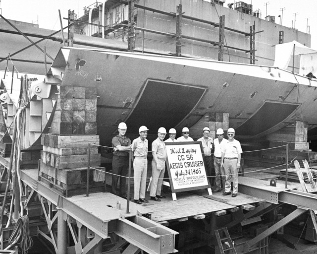 The keel laying of Aegis cruiser (CG 56) is observed by, left to right: Ray Harbrecht, director, Ingalls Ships Management; Captain (CAPT) Blair Ireland, Aegis area commander; CAPT G.W. Dowell, supervisor of shipbuilding; L.T. Henderson, program manager; Earl Buckley, general superintendent; and Charles Brannon, hull foreman