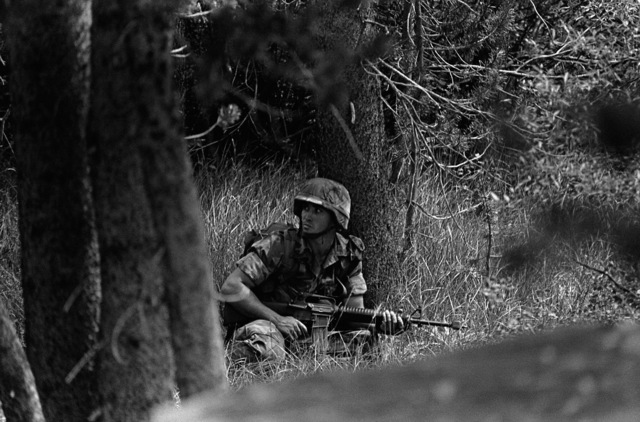 Corporal (CPL) Michael Shields of Weapons Platoon, Company H, armed with an M16A2 rifle, acts as the point man during mountain warfare training