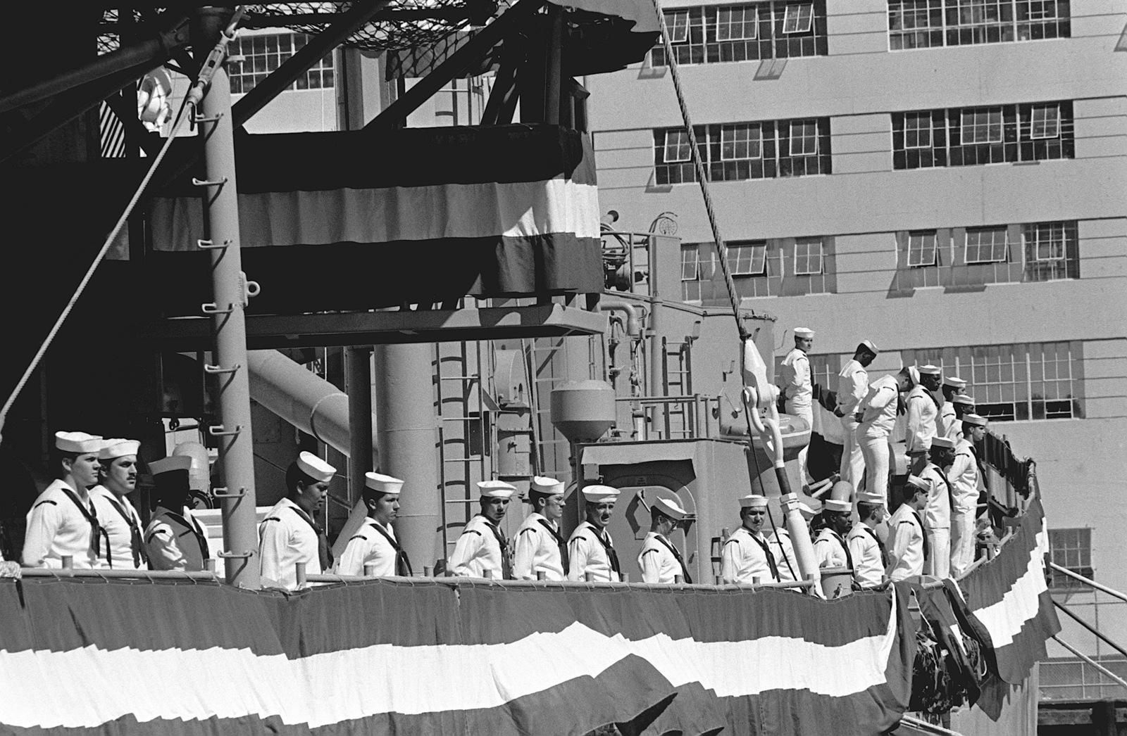 The crew of the small repair ship USS SPHINX (ARL 24) man