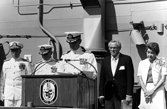 """CAPT. Joseph F. Brennan addresses guests at the commissioning of the guided missile frigate USS CARR (FFG-52). Other dignitaries attending are, from the left: Rear Adm. Laverne S. Severance Jr, commander, Naval Base, Seattle; Commodore David F. Chandler, deputy commander, Naval Surface Force; Jack Yusen, """" SAMUEL B. ROBERTS"""" Survivors Association; and Sponsor Goldie Carr Bensilhe"""