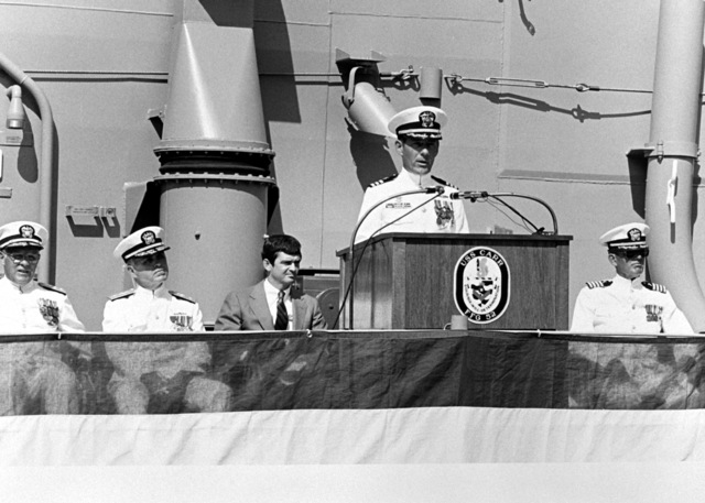 CMDR. Robert J. Horne, commanding officer of the guided missile frigate USS CARR (FFG-52), addresses guests during the ship's commissioning. Seated in the background are, from the left: Rear Adm. Laverne S. Severance Jr., commander, Naval Base, Seattle; Commodore David F. Chandler, deputy commander, Naval Surface Force; Mr. John T. Gilbride Jr., Todd Seattle and Capt. Joseph F. Brennan, chaplain, Naval Base, Seattle