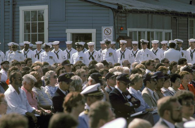 Guests attend the commissioning ceremony for the guided missile frigate USS CARR (FFG 52) at Todd Pacific Shipyards Corp. The ship's company stands at parade rest in the background