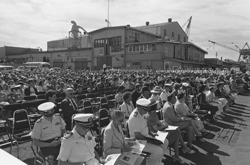 Guests attend the commissioning of the guided missile frigate USS CARR (FFG 52) at Todd Pacific Shipyards Corp. The ship's company stands at parade rest in the background