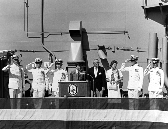 Jack Yusen, SAMUEL B. ROBERTS (DD-413) Survivors Association representative, addresses guests at the commissioning of the guided missile USS CARR (FFG-52). John T. Gilbride Jr, vice president and general manager, Todd Seattle, is seated in the background