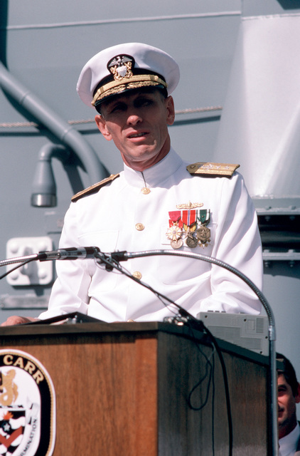 Rear Admiral George W. Davis Jr., commander, Naval Surface Force, US Pacific Fleet; speaks during the commissioning ceremony for the guided missile frigate USS CARR (FFG 52) at Todd Pacific Shipyards Corp