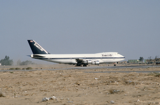 A contract Boeing 747 aircraft taxis on the flight line during the multinational joint service Exercise BRIGHT STAR '85