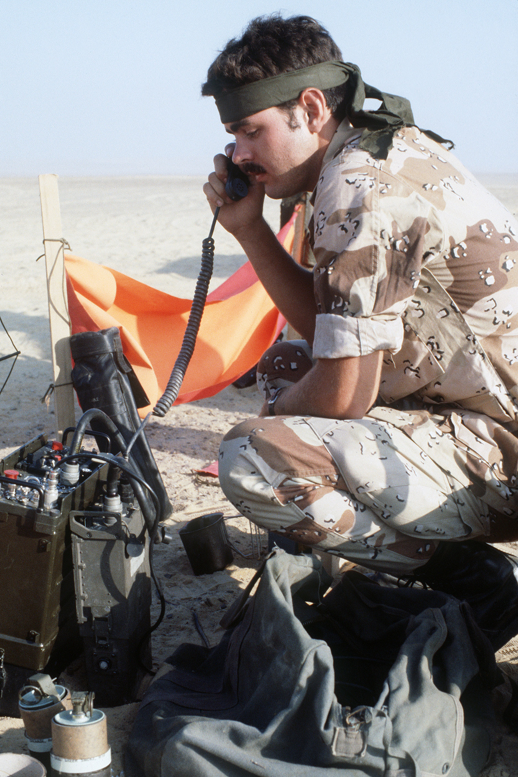 A member of a combat control team talks on a field radio at a drop zone during the multinational joint service Exercise BRIGHT STAR '85
