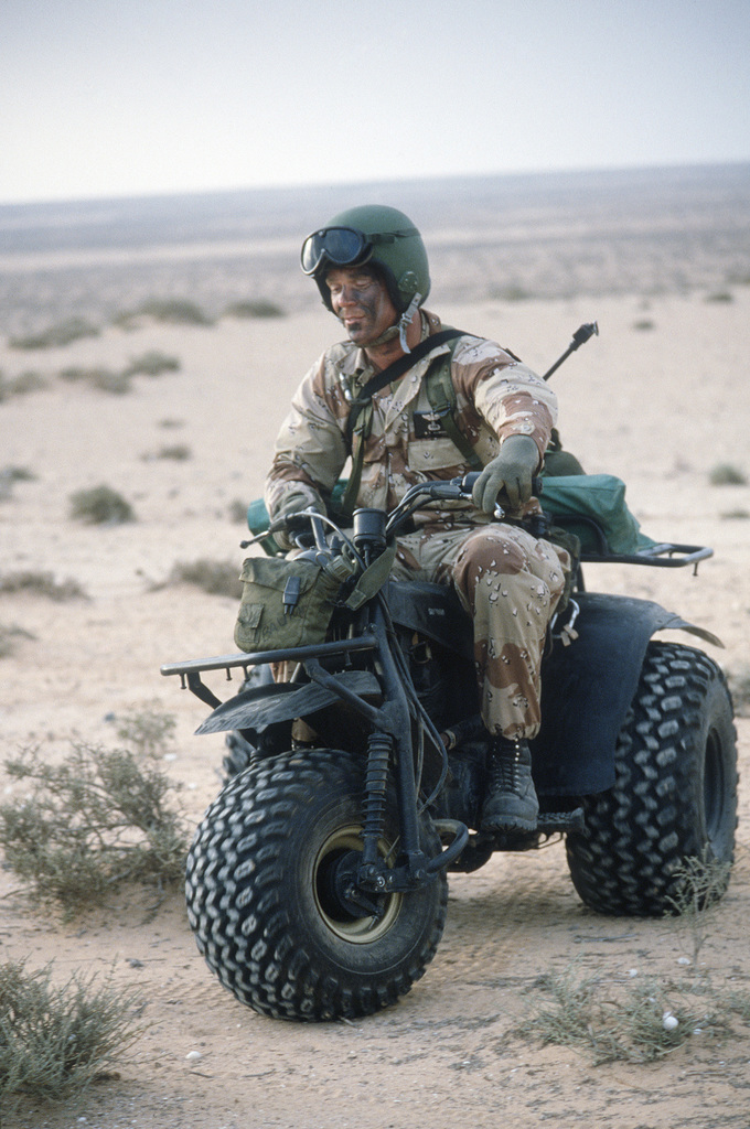 A member of the 1721st Combat Control Team operates a three-wheeled all-terrain vehicle while clearing a drop zone for an airborne assault operation during the multinational joint service Exercise BRIGHT STAR '85