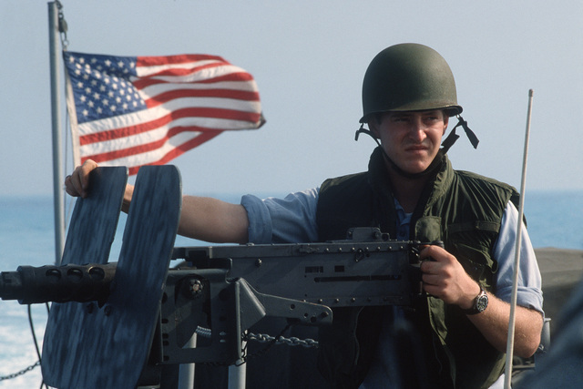 A salior mans an M-2.50-caliber machine gun aboard a utility landing craft as the craft prepares to land on the Egyptian coast during the multinational joint service Exercise BRIGHT STAR '85