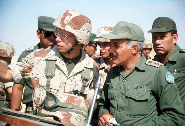 A U.S. Marine Corps officer discusses a live fire demonstration with an Egyptian general officer during the multinational joint service Exercise Bright Star '85