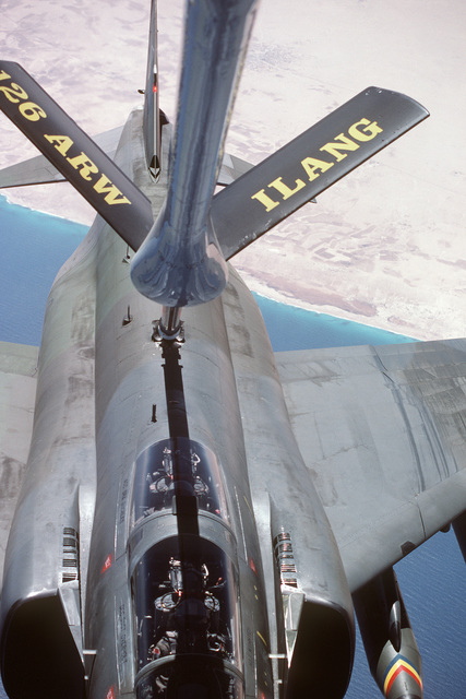 A view from the boom operator's station of a KC-135E Stratotanker aircraft of the 126th Air Refueling Wing, Illinois Air National Guard, as it refuels an F-4E Pantom II aircraft during the multinational joint service Exercise BRIGHT STAR '85