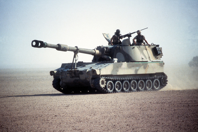 An M-109 155 mm self-propelled howitzer participates in desert maneuvers during the multinational joint service Exercise Bright Star '85